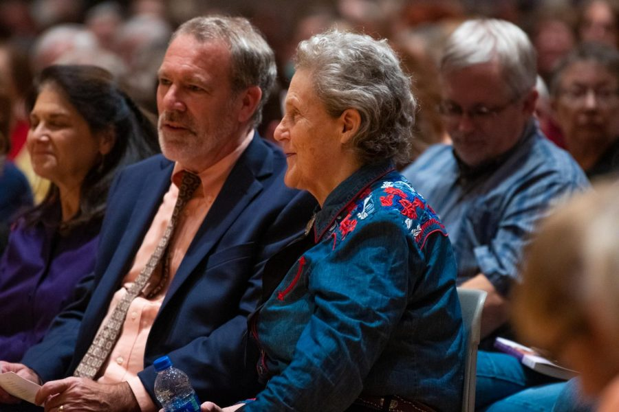 Institute Director of the Paul Simon Public Policy Institute John Shaw and Temple Grandin talk before her speech on Thursday, Oct. 3, 2019, inside the Student Center.