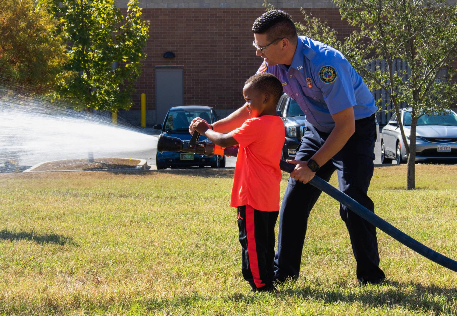 Four-year-old Jeremiah Davis uses the fire hose in one of the many activites hosted by the Carbondale Fire Department at their open house on Saturday, October 5th to kick off National Fire Prevention Week.