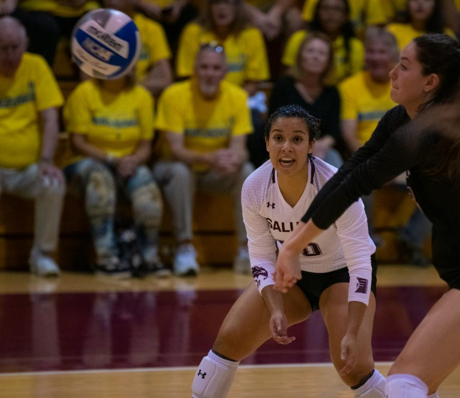 Saluki Laura Rojas watches as Rachel Maguire hits the ball on Saturday, Oct. 5, 2019 during the Salukis' 0-3 loss against the University of Northern Iowa Panthers inside Davies Gym.
