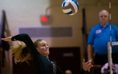Saluki Emma Baalman spikes the ball on Saturday, Oct. 5, 2019 during the Salukis' 0-3 loss against the University of Northern Iowa Panthers inside Davies Gym.