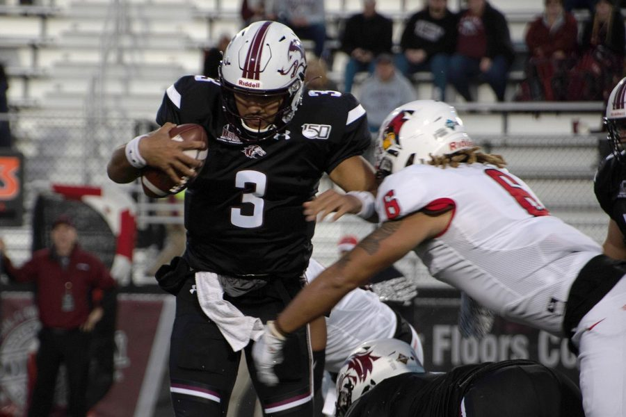 Saluki quarterback Karé Lyles protects the ball on Saturday, Oct. 12, 2019 at SIU Arena during the Salukis' 7-21 loss against the Tennessee-Martin Skyhawks.