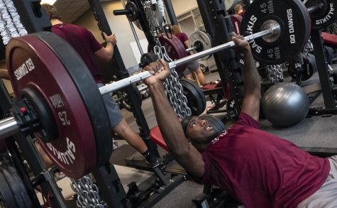 Sophomore Je'Quan Burton, of Orlando, Fla., studying Sports Administration, lifts a barbell on Friday, Oct. 11, 2019, in the Banterra Center's Gym.
