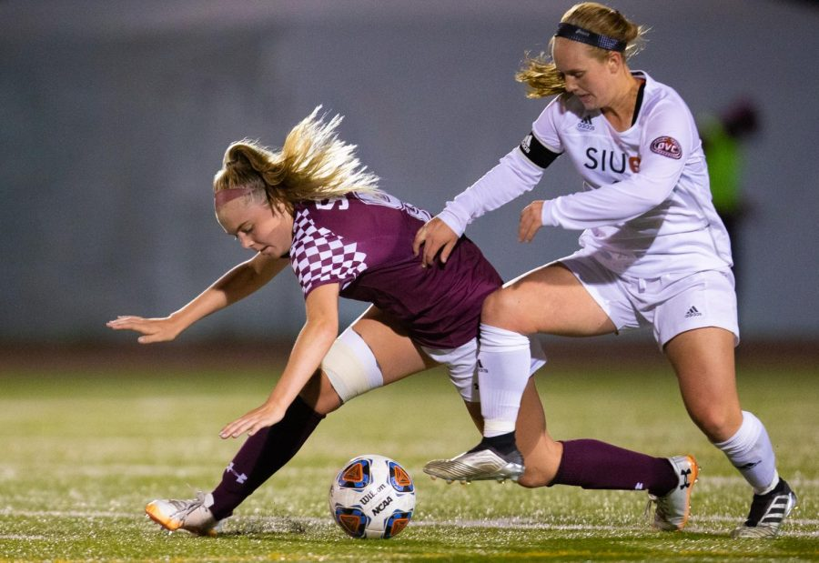 Saluki freshman Christy Murauskis attempts to take control of the ball on Friday, Oct. 18, 2019 during the Salukis' 0-2 loss against SIUE Cougars at the Lew Hartzog Track & Field Complex.