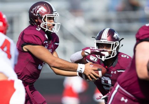 Saluki quarterback Karé Lyles hands off the ball to D.J. Davis on Saturday, Oct. 19, 2019 during the Salukis