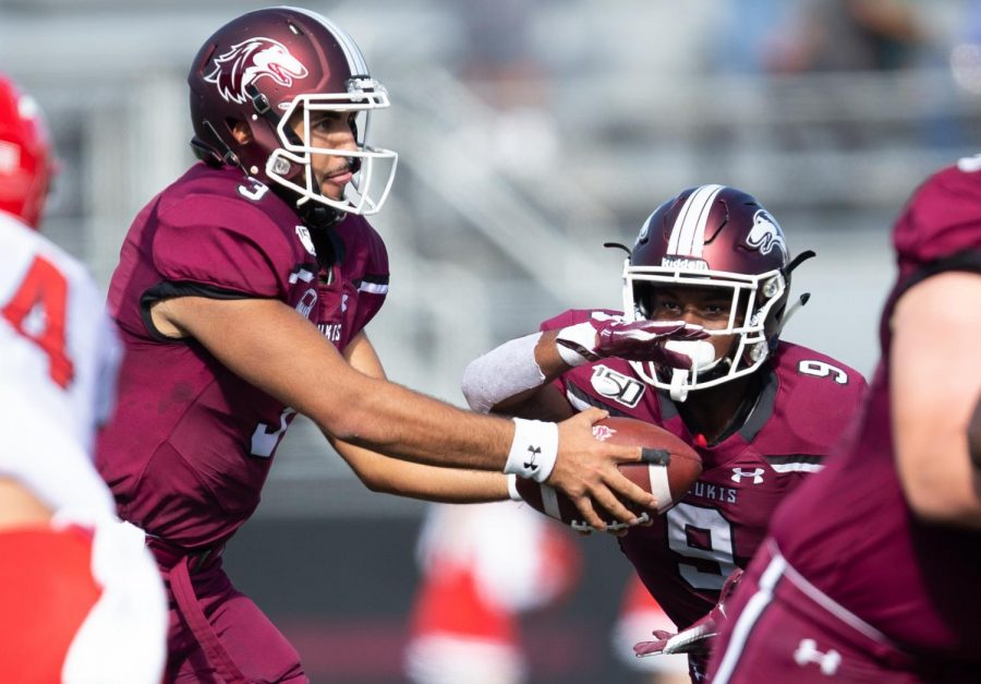 Saluki quarterback Karé Lyles hands off the ball to D.J. Davis on Saturday, Oct. 19, 2019 during the Salukis' 35-10 win against the Youngstown State Penguins.