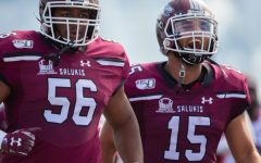 Salukis' Keenan Agnew and Javon Williams Jr. react on Saturday, Oct. 19, 2019 during the Salukis' 35-10 win against the Youngstown State Penguins.