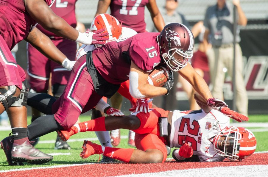 Saluki+Running+Back+Javon+Williams+Jr.+scores+a+touchdown+during+the+Homecoming+game+on+Saturday%2C+Oct.+19%2C+2019+during+the+Salukis%27+35-10+win+against+the+YSU+Penguins.