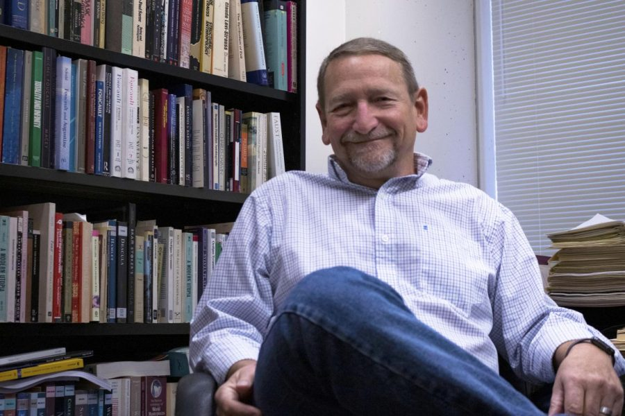 English Professor Michael L. Humphries in his office Friday, October 11, 2019. He will be teaching a 400 level course featuring literature from Holocaust victims.
