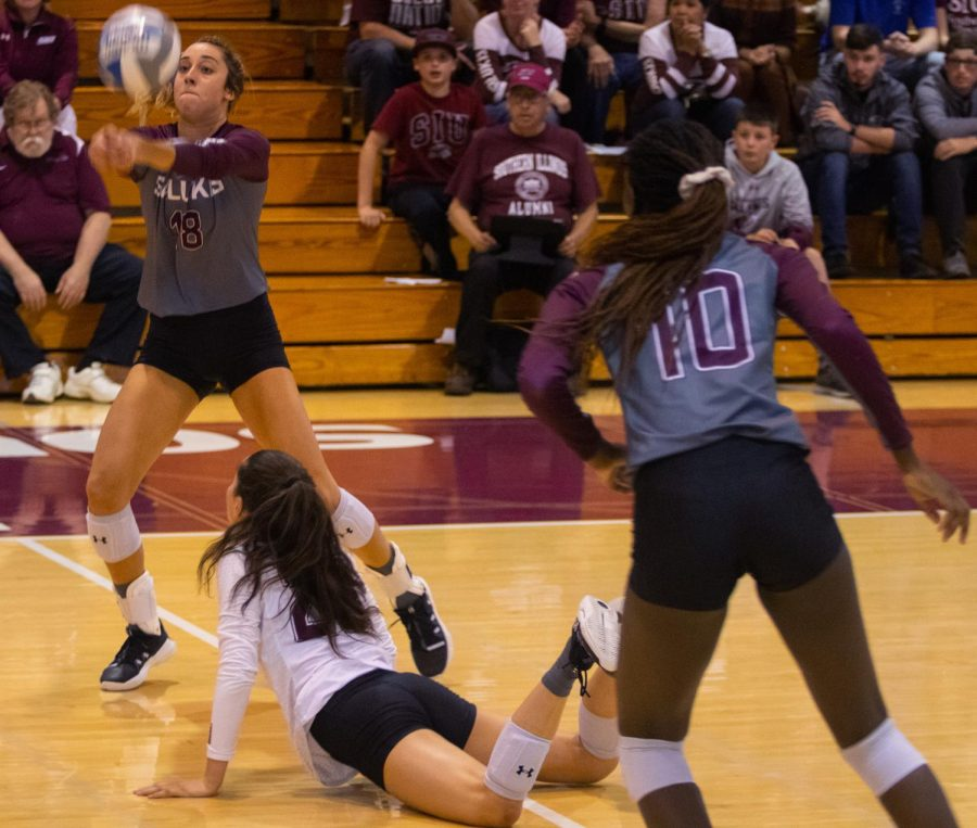 Saluki Katy Kluge dives for the ball while teammate Alayna Martin to set up the drive on Saturday, Oct. 19, 2019 during the Saluki's 2-3 loss in Davies gym.