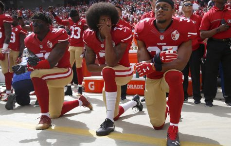 From left, The San Francisco 49's Eli Harold (58), Colin Kaepernick (7) and Eric Reid (35) kneel during the national anthem before their a game against the Dallas Cowboys on October 2, 2016, at Levi's Stadium in Santa Clara, Calif. Photo courtesy of Nhat V. Meyer/Bay Area News Group/TNS.