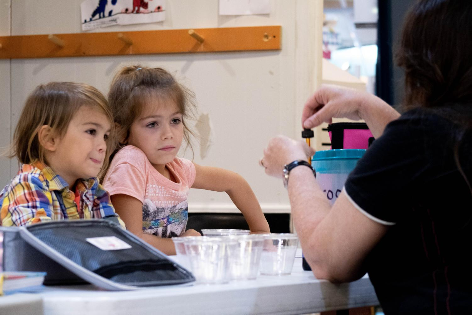 Graham, age 4, and Audry, age 7, learning about the properties of water at The Science Center's new home school camp on Friday September, 27, 2019.