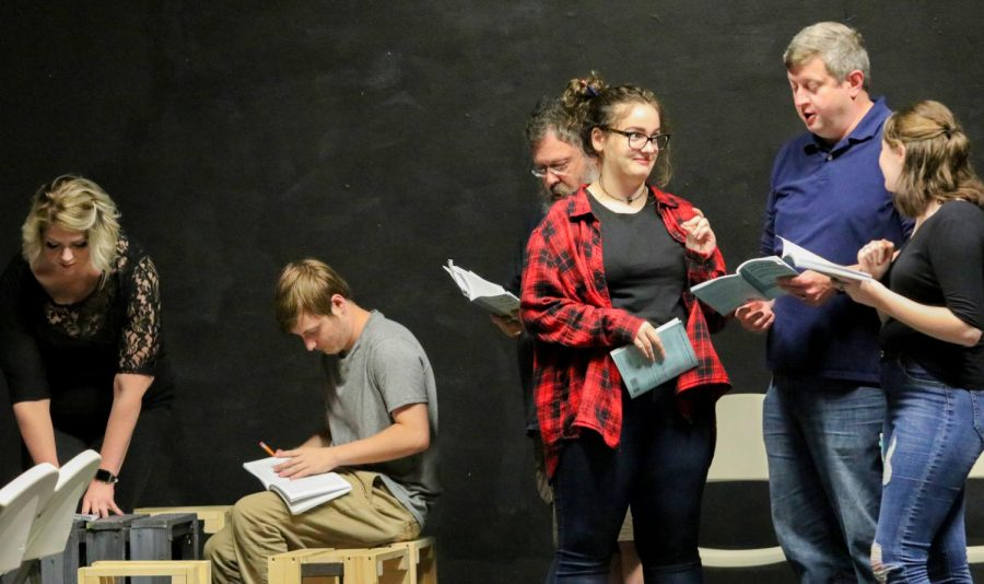 Actors take notes on Wednesday, Sept. 25, 2019 during rehearsal to prepare for their final performance at The Varsity Center in Carbondale.