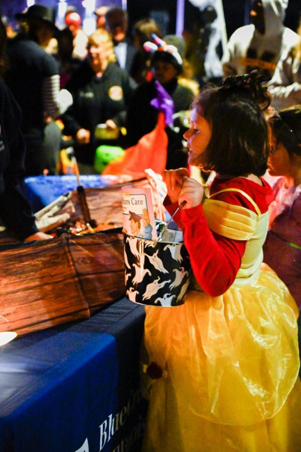 Alisyen McKinney dressed as her favorite Disney princess and picking out candy at the Marion PD Spooktacular on Saturday, October 26 2019.