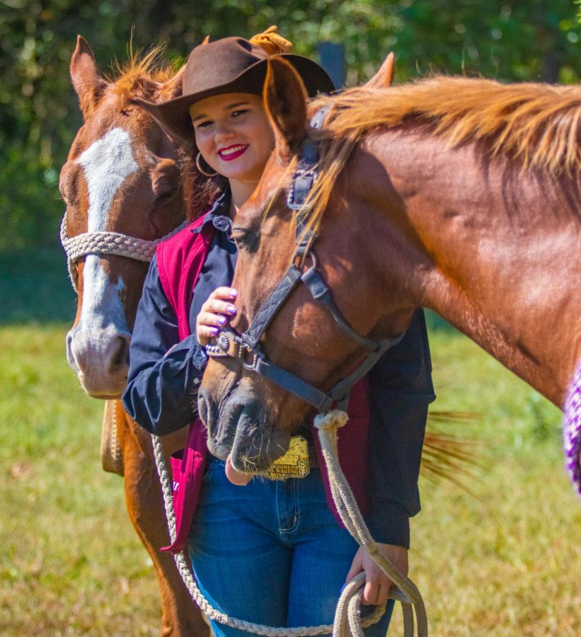 Kaitlin McWhorter, SIU's sole rodeo competitor, stands with her horses. McWhorter said she has a relationship with all of her horses.