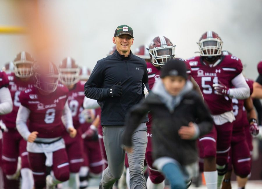 Head Coach Nick Hill runs onto the field on Saturday, Nov. 23, 2019, during the Saluki's 7-21 loss against the North Dakota State Bison.