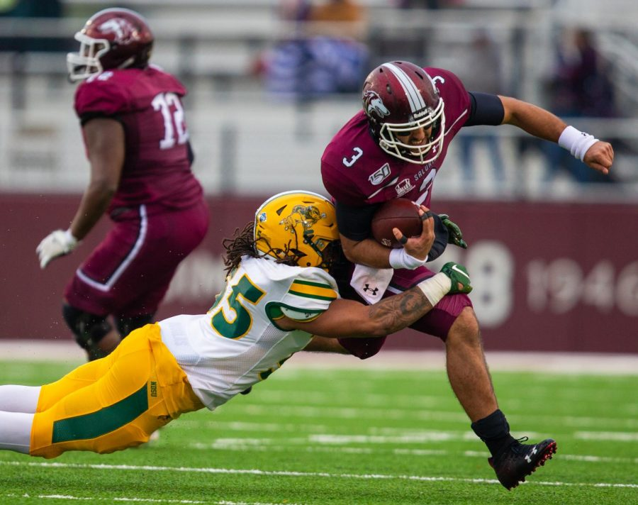 Saluki Karé Lyles is tackled on Saturday, Nov. 23, 2019, during the Saluki's 7-21 loss against the North Dakota State Bison.