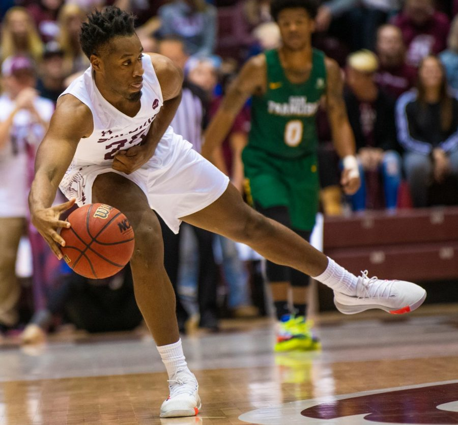 Junior forward Brendon Gooch passes the ball on Saturday, Nov. 16, 2019 during the Salukis' 60-76 loss to the San Francisco Dons inside the Banterra Center.