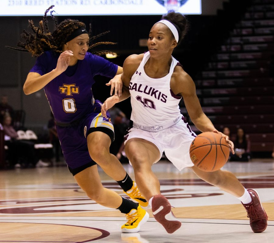 Senior guard Brittney Patrick moves the ball forward on Saturday, Nov. 16, 2019 during the Salukis' 76-65 win against the Tennessee Tech University Golden Eagles.
