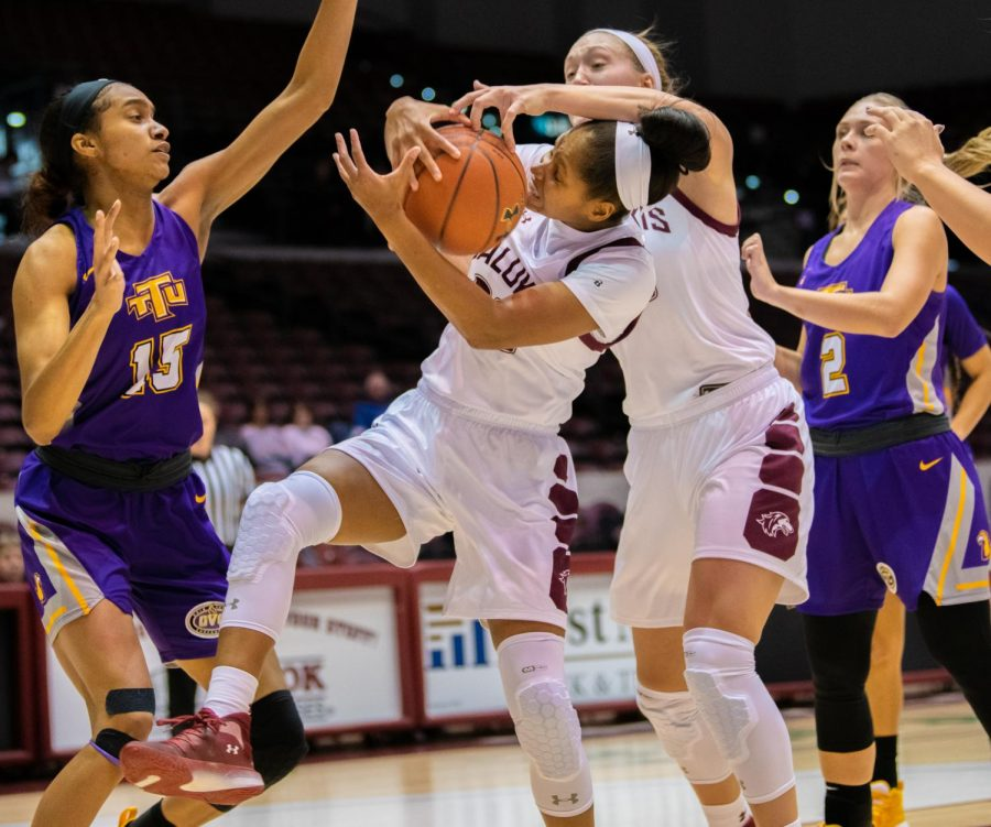 Senior guard Kirsten Nelson grapples for the ball on Saturday, Nov. 16, 2019 during the Salukis' 76-65 win against the Tennessee Tech University Golden Eagles.