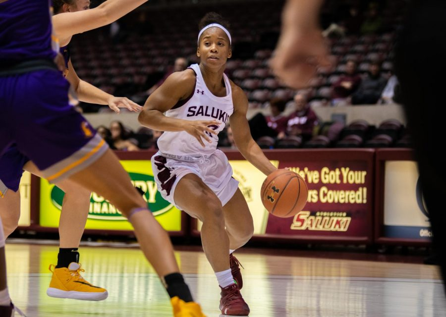 Senior guard Brittney Patrick looks to pass the ball on Saturday, Nov. 16, 2019 during the Salukis' 76-65 win against the Tennessee Tech University Golden Eagles.