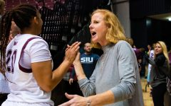 Athletic Director Liz Jarnigan congratulates players after the game on Saturday, Nov. 16, 2019 after the Salukis 76-65 win against the Tennessee Tech University Golden Eagles.