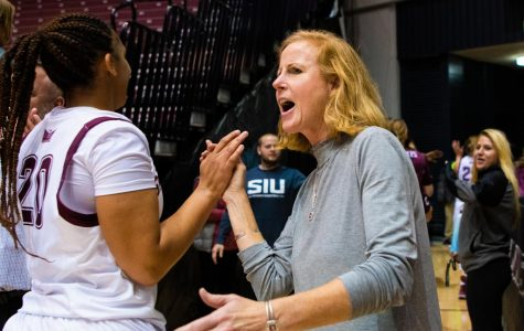 Athletic Director Liz Jarnigan congratulates players after the game on Saturday, Nov. 16, 2019 after the Salukis' 76-65 win against the Tennessee Tech University Golden Eagles.