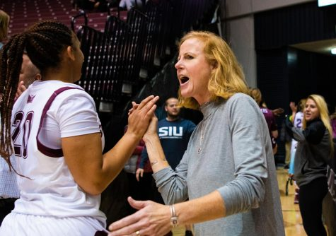 Athletic Director Liz Jarnigan congratulates players after the game on Saturday, Nov. 16, 2019 after the Salukis