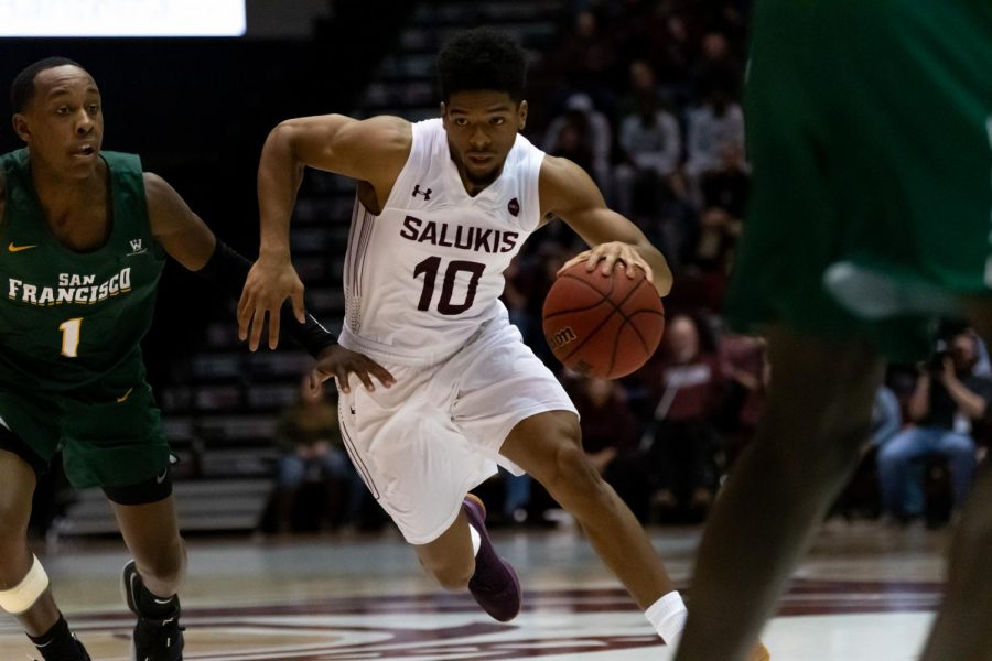 Senior, Guard, Aaron Cook Jr. moves the ball down the court to his teammates on Saturday, Nov. 16, 2019 during the Saluki's 60-76 loss to the San Francisco Dons inside the Banterra Center.