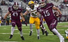 Javon Williams Jr., of Centralia, runs past a defender on Saturday, Nov. 23, 2019, at the SIU vs. North Dakota State Football game in Carbondale.