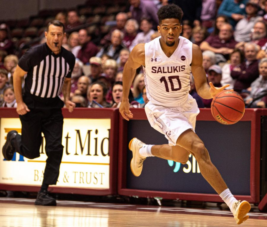 Saluki+guard+Aaron+Cook+breaks+away+with+the+ball+on+Tuesday%2C+Nov.+6%2C+2019%2C+during+the+Salukis%27+76-48+win+against+the+Illinois+Wesleyan+Titans+inside+the+Banterra+Center.
