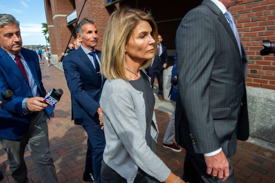 Actress Lori Loughlin and husband Mossimo Giannulli exit the Boston Federal Court house after a pre-trial hearing with Magistrate Judge Kelley at the John Joseph Moakley US Courthouse in Boston on Aug. 27, 2019. (Joseph Prezioso/AFP/Getty Images/TNS)
