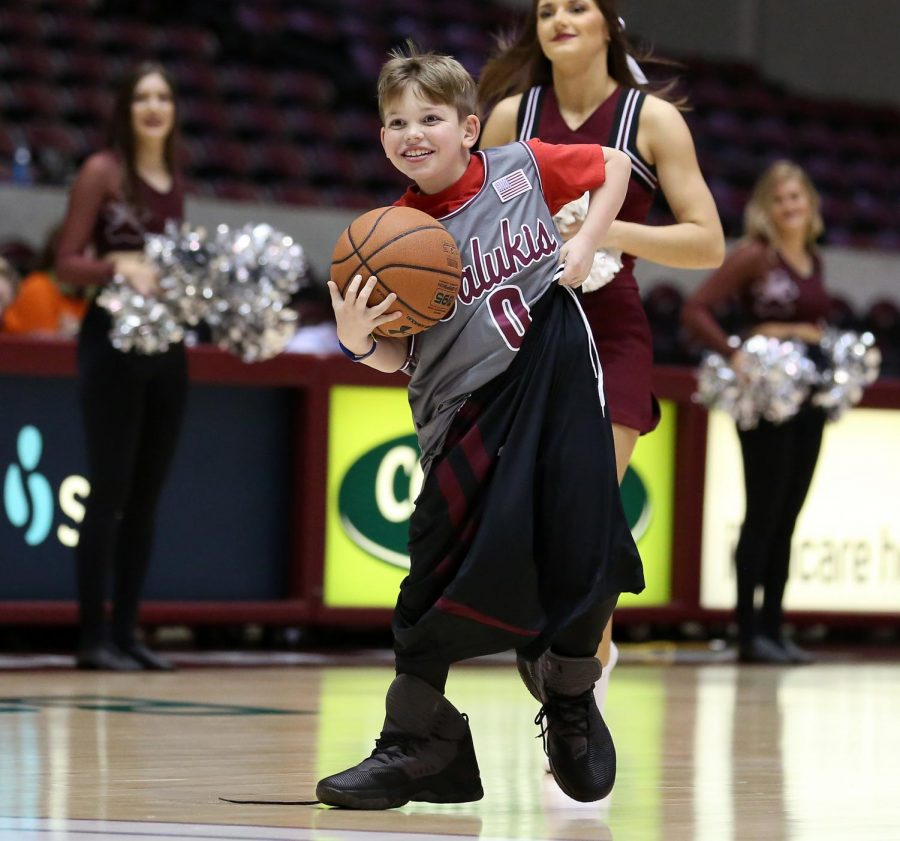 Ten-year-old Wyatt Koth, of Carterville, participates in half-time fun on Friday, January 10, 2020, during the Salukis' 60-57 loss to the Northern Iowa Panthers inside the Banterra Center.