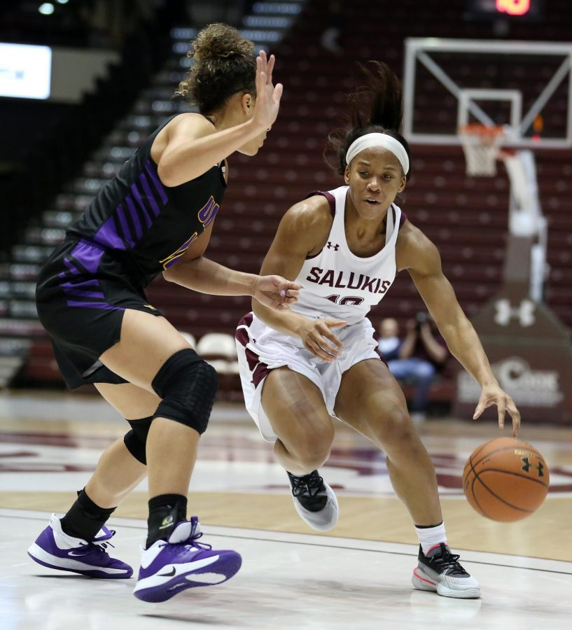 Saluki guard Brittney Patrick moves the ball past Panthers guard Kam Finley on Friday, January 10, 2020, during the Salukis' 60-57 loss to the Northern Iowa Panthers inside the Banterra Center.