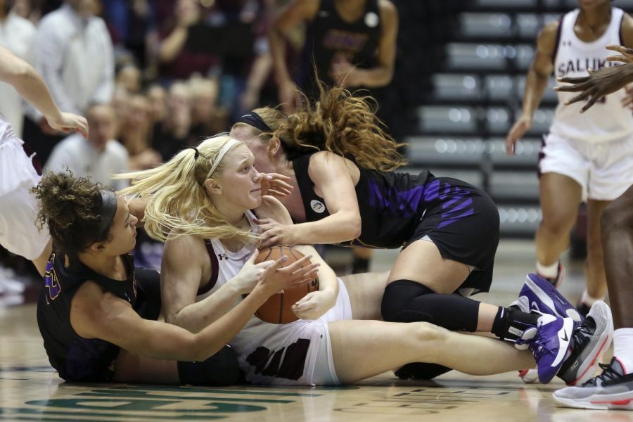 Saluki guard Caitlin Link wrestles for the ball on Friday, January 10, 2020, during the Salukis' 60-57 loss to the Northern Iowa Panthers inside the Banterra Center.