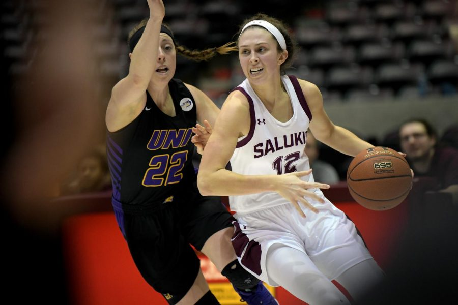 Saluki guard Makenzie Silvey tries to move the ball past Panthers guard Rose Simon-Ressler on Friday, January 10, 2020, during the Saluki's 60 - 57 loss to the Northern Iowa Panthers inside the Banterra Center.