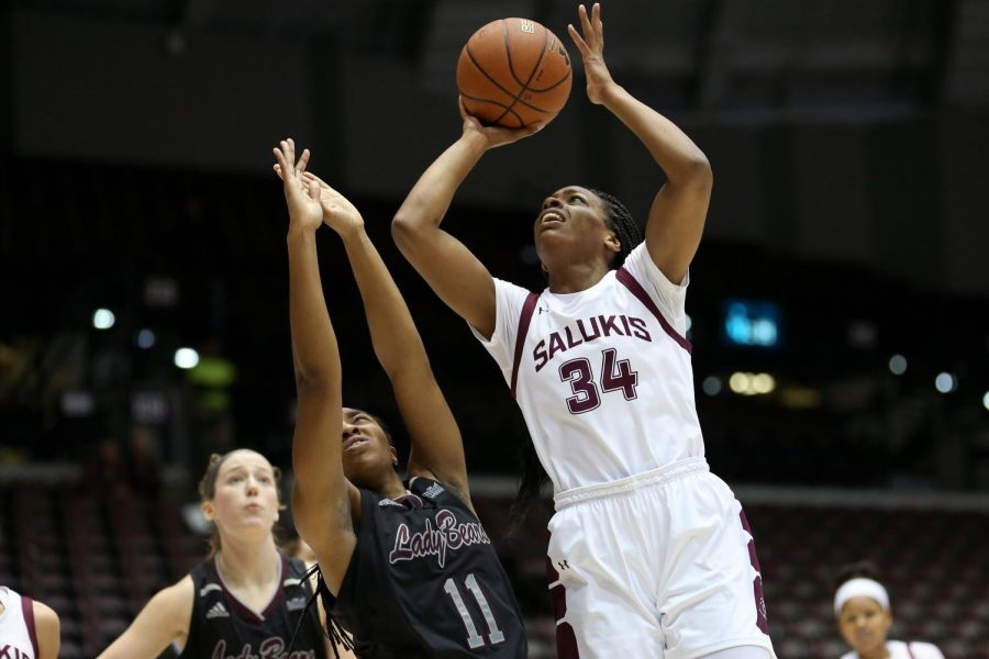 Saluki forward Nicole Martin goes up for two leaping over the Lady Bears guard Brice Calip on Friday, January 17, 2020, during the Salukis' dramatic 70-68 victory over the Missouri State Lady Bears at the Banterra Center.
