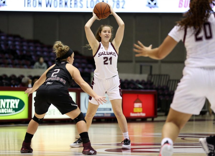 Saluki guard Payton McCallister looks to pass the ball on Friday, January 17, 2020, during the Salukis' dramatic 70-68 victory over the Missouri State Lady Bears inside the Banterra Center. (Angel Chevrestt)