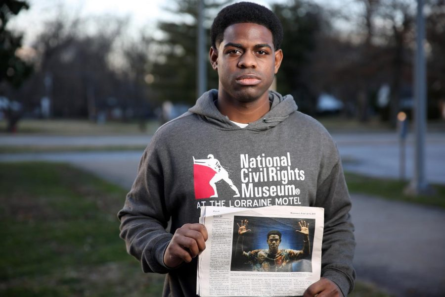 Travis Washington of Flossmoor, IL holds a Daily Egyptian news article, which ran on 02/06/19 and featured Washington, on the SIU campus on Saturday, January 18, 2020, Carbondale, Illinois.  Washington, 25, graduated with his MA degree in Education Administration last May from the SIU graduate program, and has been the force behind the 'Hands Up Act', a piece of legislation that would make it illegal for police officers to shoot someone if the person is found to be unarmed.
