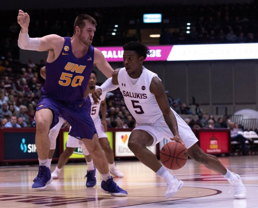 Southern Illinois University's Freshman gurd Lance Jones defends the ball from University of Nothern Iowa's Forward Austin Phyfe during the Wednesday January 22, 2020 game in SIU's Bantera Arena. The game ended at 68 SIU and 66 UNI.