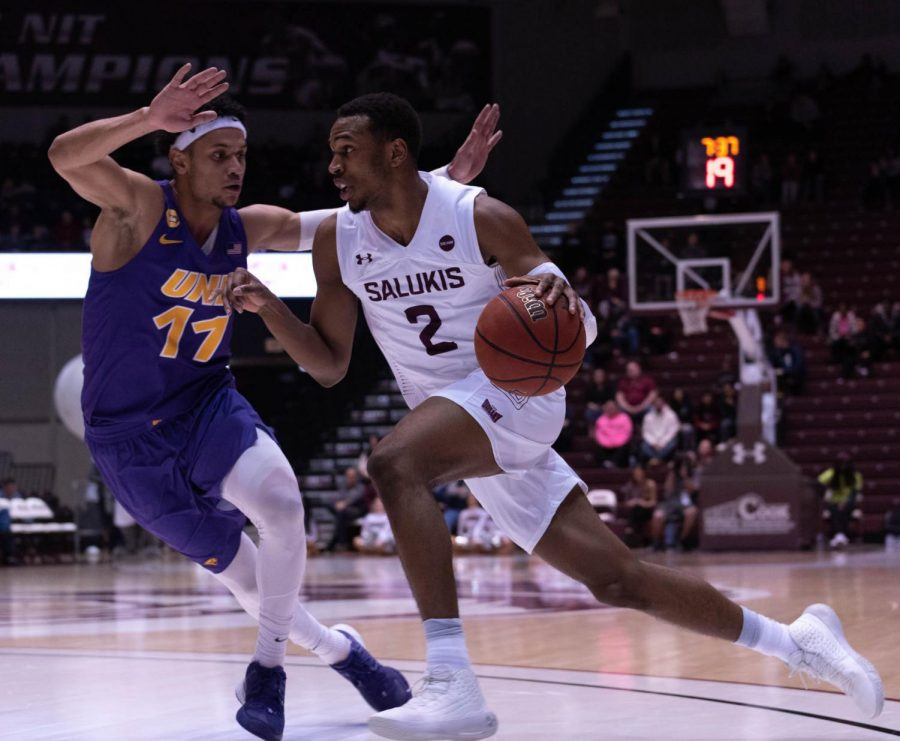 Southern Illinois University's Freshman guard Karrington Davis protects the ball from University of Northern Iowa's Junior guard Trae Berhow during a basketball game at the SIU Bantera Arena on Wednesday January 22, 2020.  The game ended at 68 SIU and 66 UNI.