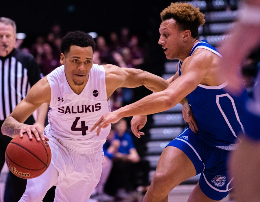 Salukis senior guard Eric McGill goes against a Bulldog defender during SIU's 66-49 win over Drake on Sunday, Jan. 19, 2020 at the Banterra Center.