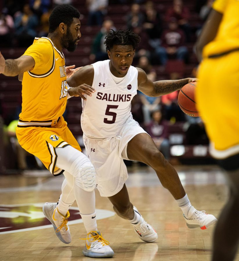 SIU Freshman Lance Jones goes against a Crusader defender during Tuesday's 63-50 win vs. Valparaiso at the Banterra Center in Carbondale, IL.