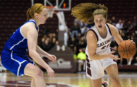 SIU guard Payton McCallister works her way inside against a Bulldog defender during 73-65 loss to Drake on Sunday, Jan. 12, 2020 in the Banterra Center.