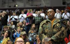 Veterans stand as the Banterra Center erupts in cheers during the ceremony of the mobilization of the members of the Illinois National Guard 2nd Battalion 130th Infantry Regiment on Tuesday, Jan. 21, 2020 in the Banterra Center in Carbondale, IL.