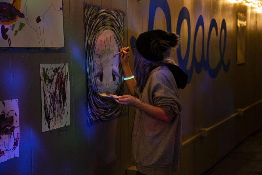 Elyse Hickey of Peoria paints at the paint party hosted by Project Human X early Sunday morning during Polar Bear Weekend 2020.