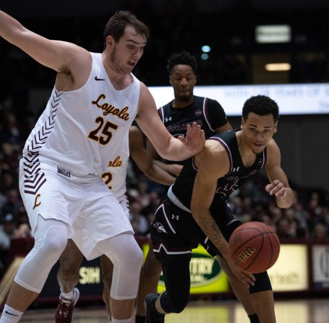 Southern Illinois Salukis  Senior Guard Eric McGill defends the ball in the game against Lyola Ramblers 68 to 63 in the Wednesday January 29, 2020 game at the SIU Bantera Arena.