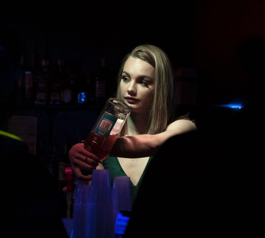 Lauren Senf, a junior studying marketing from St. Louis, mixes a drink Saturday, Jan. 25 at Levels in Carbondale.
