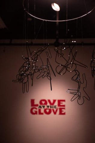 A hanging metal sculpture greets guests at the Love at the Glove Valentines day art show in SIU