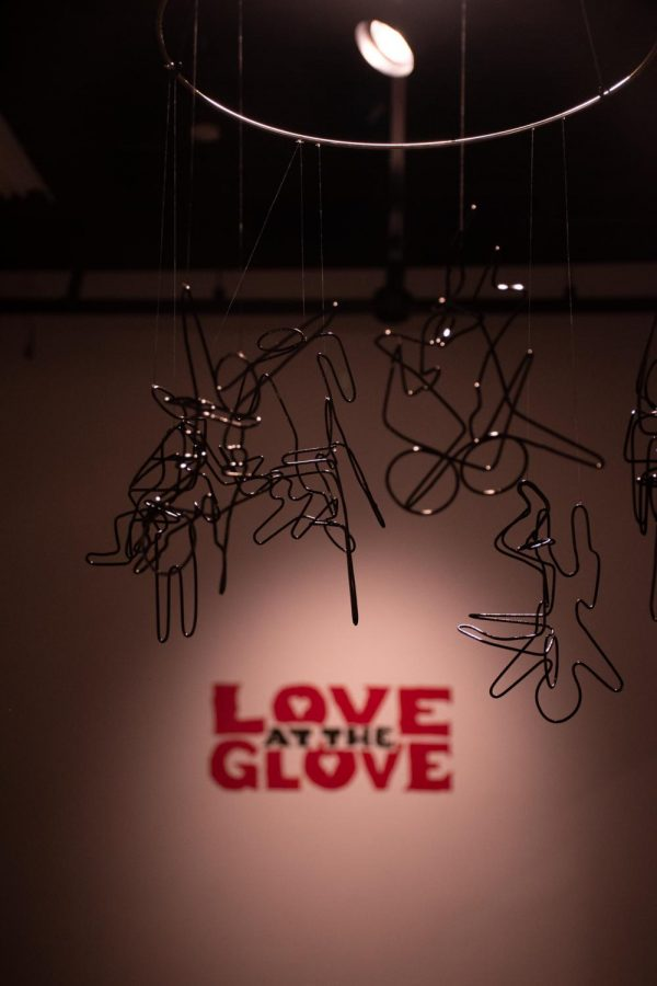 A hanging metal sculpture greets guests at the Love at the Glove Valentines day art show in SIU's glove factory.