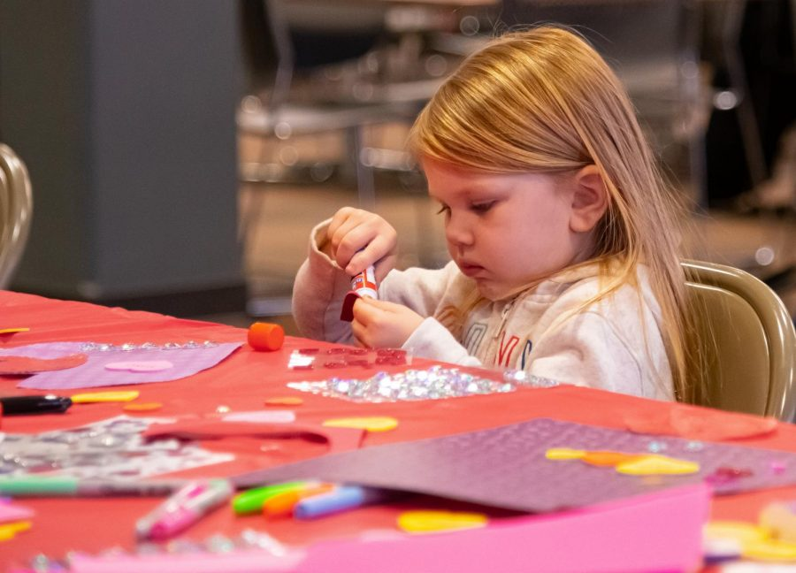 Valentines Felicity Swain, 2, makes a Valentine's Day card at the card making station put on by Student Programming Council on Friday, Feb. 14, 2020  at the Student Center at SIU.